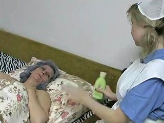 Cute Nurse In Lesbian Foreplay With Granny