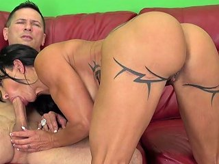Cougar With Big Knockers And Tats Gets Some Younger Cock