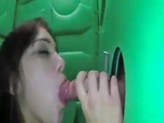 College Girl Gives Gloryhole Blowjob To Strangers For